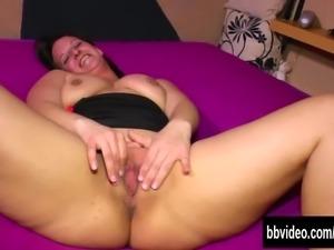 Tattooed milf masturbating her pussy