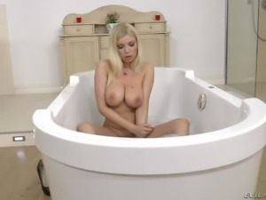 Naked blonde MILF Donna Bell with a perfect body shows off her massive tits...