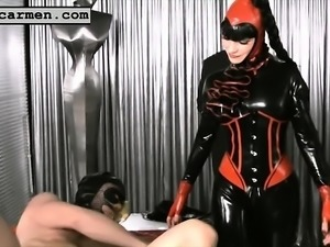 Nasty mistresses in latex tie up their slave and fuck him in the ass