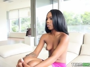 Enticing caramel cutie oils up her body and wildly fucks a big stick