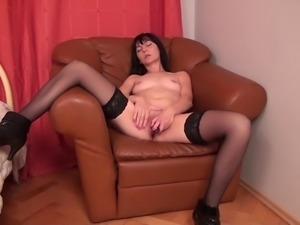 Dark-haired mature chick called Emily decides to play with her pussy