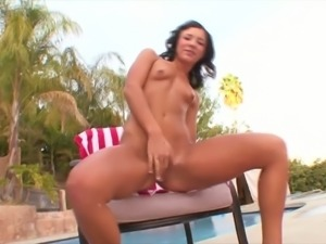 Petite black haired slut Ashli Orion performs steamy masturbation by the pool