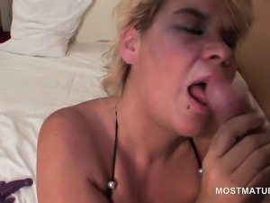 Mature cutie gets fingered and sucks cock