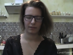 Solo girl with glasses chatting in the kitchen