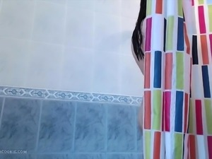 Masturbating in the shower with asian teen