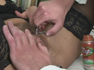 A doctor shaves her pussy then buries his dick inside