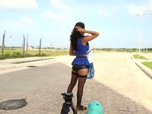 Busty Isabella Cruz posing topless for camera