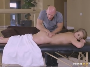 The blonde babe relaxed on the massaging table and the dirty masseur decided...