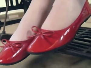 Pretty brunette chick Petra wears red flats while working with sewing machine
