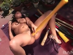 Raven haired wild housewife Emma Cummings fucks her anus and muff with...