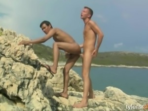 Twinks have outdoor sex by the water