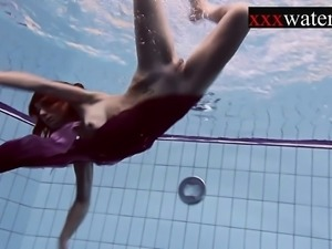 Smoking hot Russian redhead in the pool
