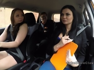 Threesome in fake driving class car