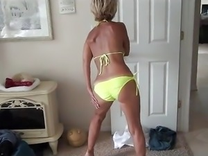 Hot Milf striiping off bikini