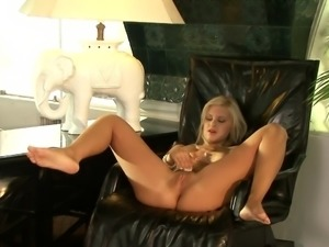 Elegant blonde Briget drills her pussy with a glass dildo