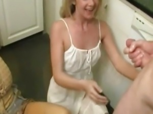 Threeway stepmom cumloaded in the kitchen