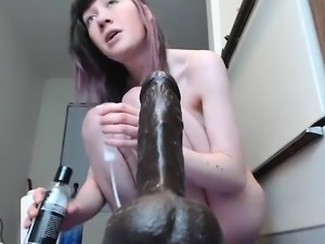 Brunette fingering with two toys
