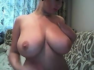 Blonde milf Tish with huge boobs masturbates