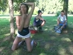 Slim playful and naughty brunette bitch exposed her body in the park
