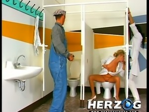 Horn-mad retro blonde slut gives blowjobs through the glory-holes