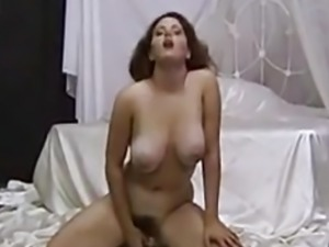 Busty amateur Jonee playing her pussy with pink toy