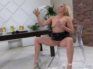 This hot MILF in leather dress is now soaked in piss