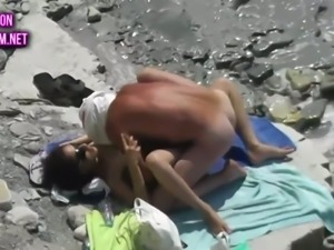 These shameless beach fuckers are enjoying some passionate fuck on the beach