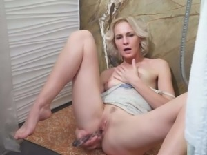 Mature blonde masturbating in the shower
