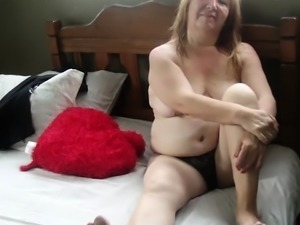Fat mature blonde sends her hands caressing her sexy curves