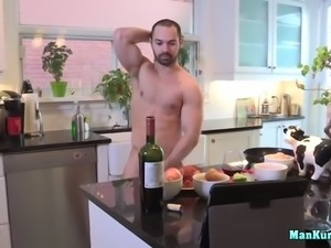 muscled jock jerking off in the kitchen