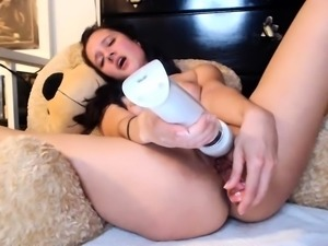 Busty brunette whore toys her cunt with big dildo